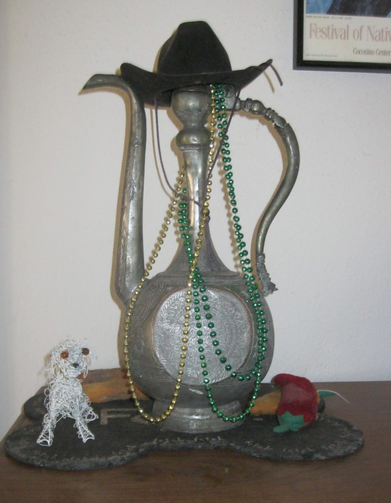 Frankie shrine with cowboy hat, squeaky chile forward
